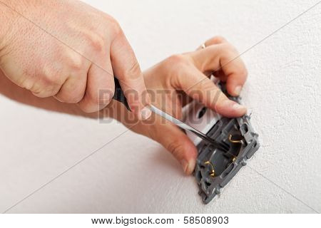 Electrician Hands Mounting Electrical Wall Fixture