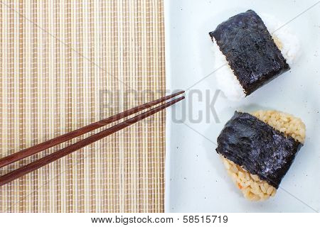 Japanese food Onigiri rice ball and eat with chopsticks