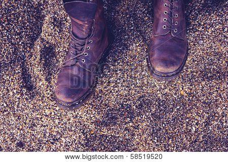 Woman's Boots On Pebble Beach