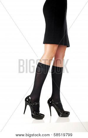Elegant woman model legs with black skirt and fashion shoes