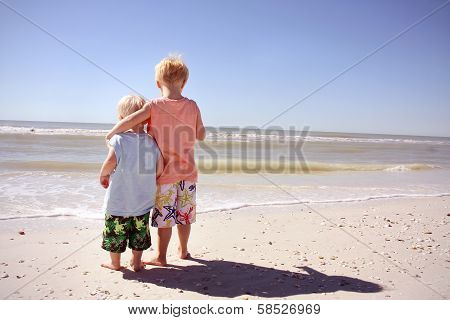 Brothers On Beach Looking At Ocean