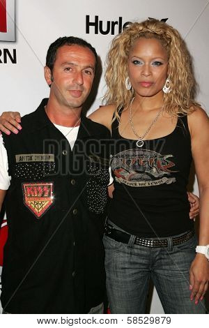 HOLLYWOOD - AUGUST 02: Jules Naouri with Blu Cantrell wearing Clothing by Antik Denim at Saturn's X-Games 12 Party at 6820 Hollywood Blvd on August 02, 2006 in Hollywood, CA.