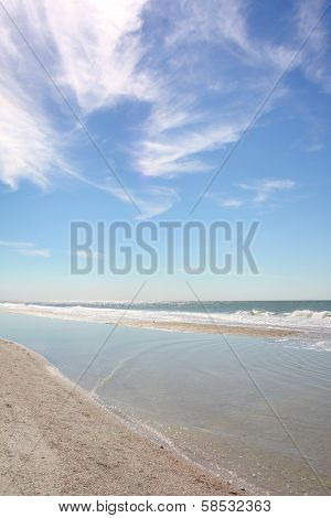 White Sandy Beach And Blue Sky