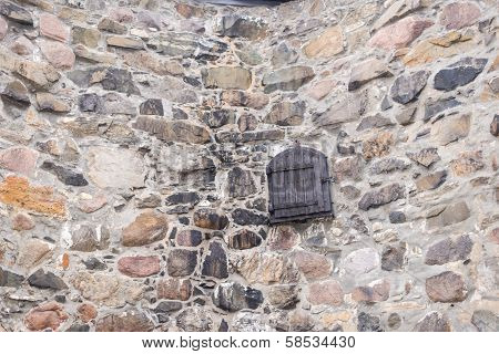 Old Field Stone Wall Background With Wooden Door