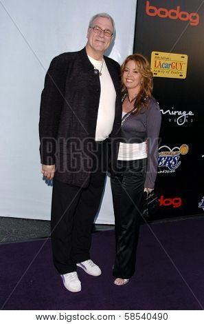 LOS ANGELES - APRIL 12: Phil Jackson and Jeanie Buss at the 3rd Annual Bodog Celebrity Poker Invitational at Barker Hangar on April 12, 2006 in Santa Monica, CA.
