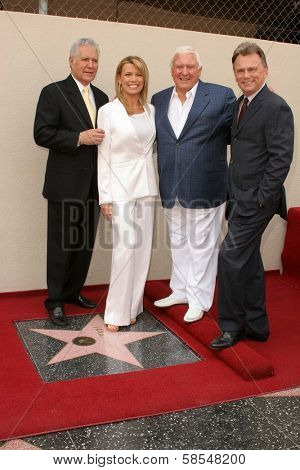 HOLLYWOOD - APRIL 20: Alex Trebek, Vanna White, Merv Griffin, Pat Sajak at the Ceremony honoring her with a star on Hollywood Walk of Fame at Hollywood Boulevard on April 20, 2006 in Hollywood, CA.