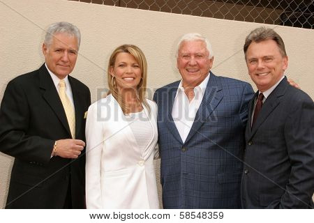 HOLLYWOOD - APRIL 20: Alex Trebek, Vanna White, Merv Griffin, Pat Sajak at the Ceremony honoring Vanna White with a star on the Hollywood Walk of Fame on April 20, 2006 in Hollywood, CA.