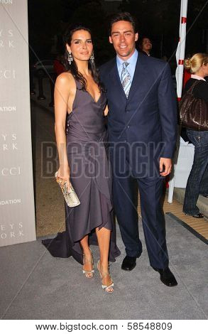 BEVERLY HILLS - APRIL 26: Angie Harmon and Jason Sehorn at the Nina Ricci Fashion Show and Gala Dinner to Benefit The Rape Foundation at Barneys New York on April 26, 2006 in Beverly Hills, CA.