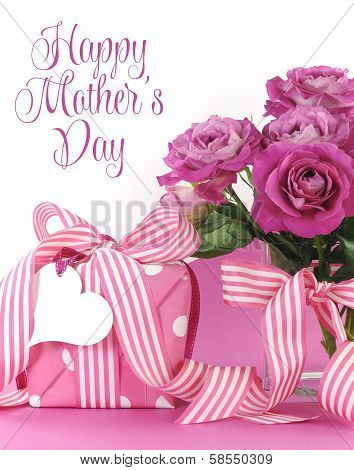 Beautiful Pink Gift And Roses On Pink And White Background With Sample Text And Copy Space For Your