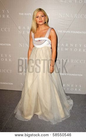 BEVERLY HILLS - APRIL 26: Elisha Cuthbert at the Nina Ricci Fashion Show and Gala Dinner to Benefit The Rape Foundation at Barneys New York on April 26, 2006 in Beverly Hills, CA.