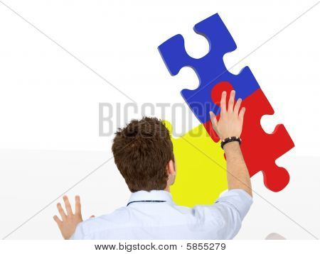 Business Man With A Puzzle