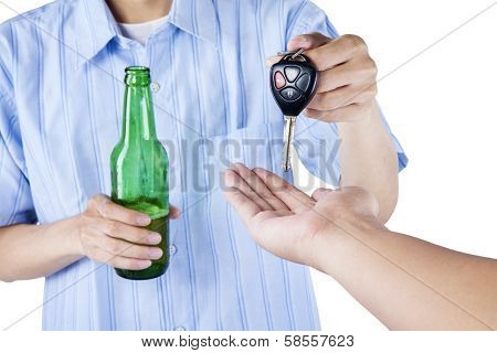 A Drunk Driver Giving A Car Key To Someone
