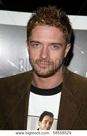 HOLLYWOOD - APRIL 05: Topher Grace at the opening of Sienna Boutique at Sienna on April 05, 2006 in Los Angeles, CA.