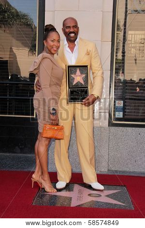 Steve Harvey and wife at the Steve Harvey Star on the Hollywood Walk of Fame, Hollywood, CA 05-13-13