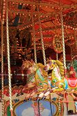 foto of carousel horse  - painted horses on a fair ground carousel