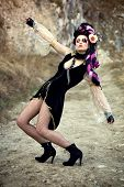 foto of diva  - Baroque diva posing on the road in ankle boots - JPG