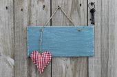 foto of wood craft  - Blank blue antique sign with red checkered  - JPG