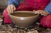 image of loam  - hands of potter do a clay pot - JPG