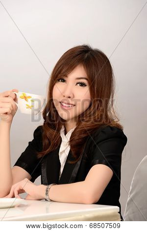 Young Business Woman Working And Drinking Coffee