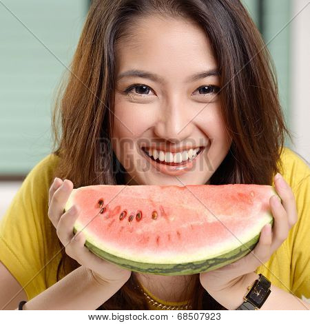 Young Asian Cute Woman Eating Watermelon
