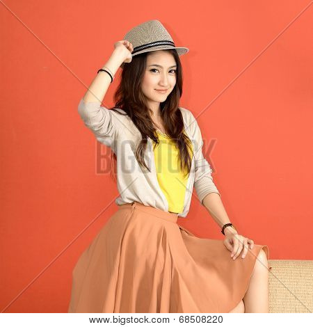 Young Asian Woman in Hat