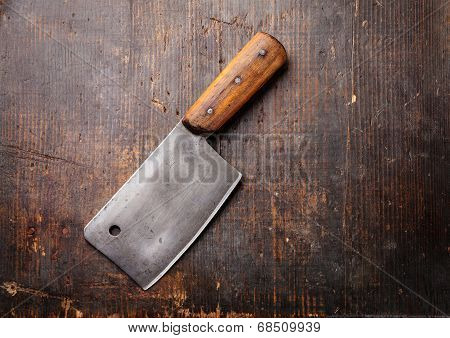 Vintage Meat Cleaver On Dark Wooden Background