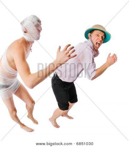 Evil Mummy Chasing Archeologist On White