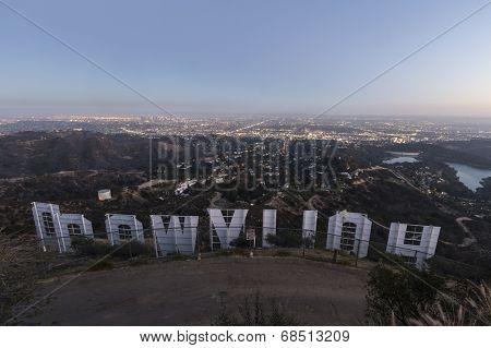 LOS ANGELES, CALIFORNIA - July 2, 2014:  Back of the Hollywood sign above the city of Los Angeles at dusk.