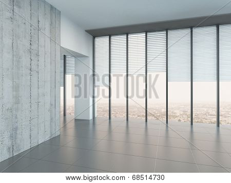 Empty bright air room with light grey walls and floor and large floor-to-ceiling windows or glass wall looking out over a town