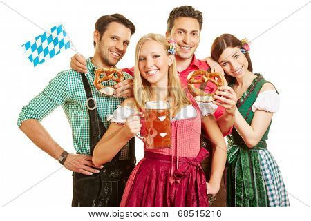 Happy group of friends celebrating Oktoberfest with beer and pretzel