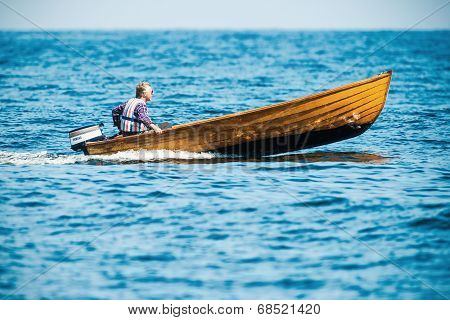 Man With A Fast Vintage Wooden Speedboat
