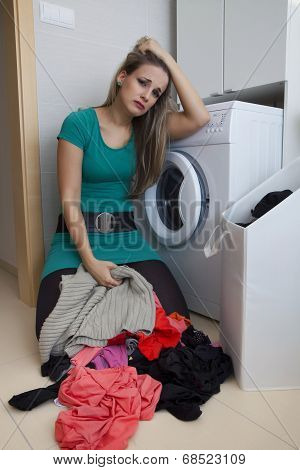 Pretty Frustrated Woman By Washing In The Bathroom