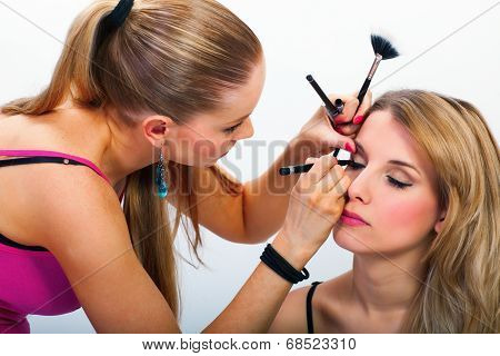 Make-up Artist Applying Mascara
