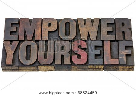 empower yourself - motivation concept - isolated text in vintage letterpress wood type blocks stained vy ink