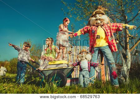 Scarecrows and children in the garden