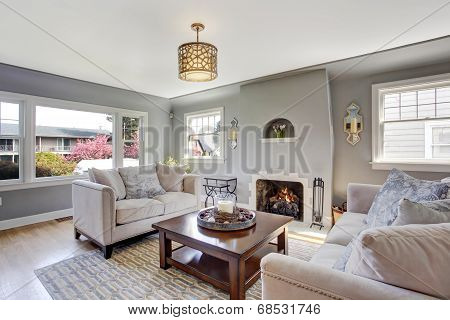 Light Grey Living Room With White Sofas And Fireplace