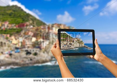 Girl Taking Pictures On A Tablet In Manorola