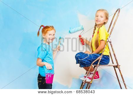 Two smiling girls with brushes
