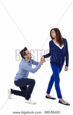 young attractive couple dressed in blue