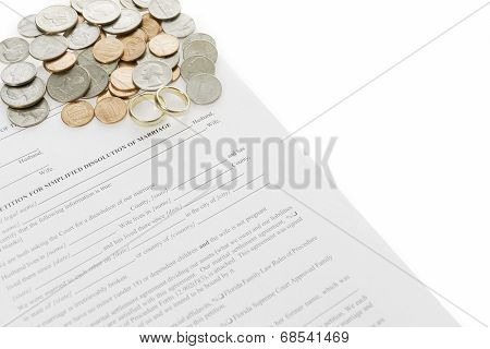Divorce Form With Loose Coins And Double Wedding Rings