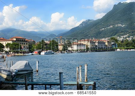 LUGANO, SWITZERLAND - JULY 5, 2014: Lugano city and shoreline.The affluent city in southern Switzerland sits on the shores of Lake Lugano a popular tourist destination.