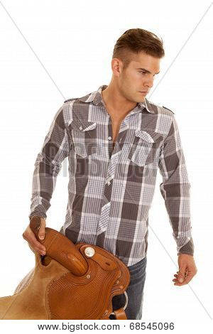 Man Plaid Shirt Holding Saddle Look To Side