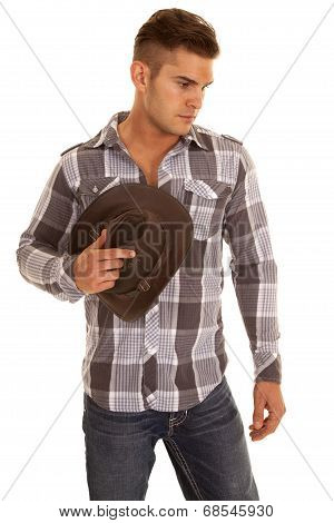 Man Plaid Shirt Western Hat In Hand Look Down
