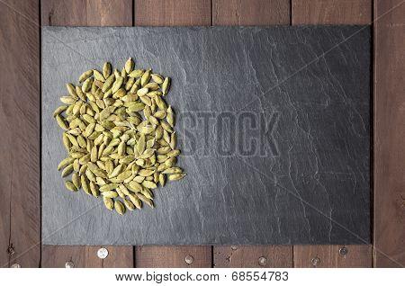 Cardamom Seeds On A Slate Plate With Copy Space