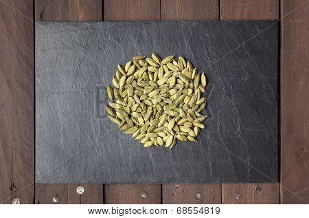 Cardamom Seeds On A Slate Plate