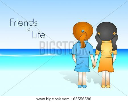 Happy Friendship Day celebrations concept with cute little girls holding hands, standing at seaside.