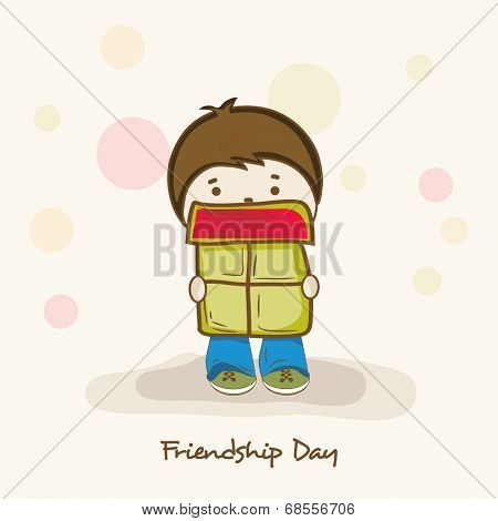 Cute little boy holding gift box on colorful abstract background on occasion of Friendship Day celebrations.