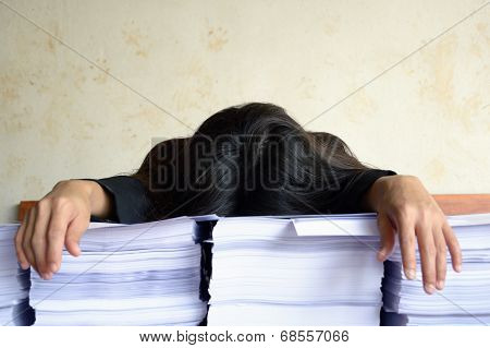 Businesswoman Tired And Sleep At Pile Of Papers