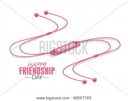 Happy Friendship Day celebrations concept with pink wrist band on white background.