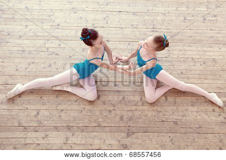 Top view of petite ballerinas dancing in studio